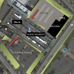 Aerial visualization of alternative development plan featuring the historic train sheds with north and south parking lots